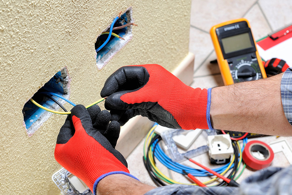 Why Do Electricians Wear Rubber Gloves While Working?